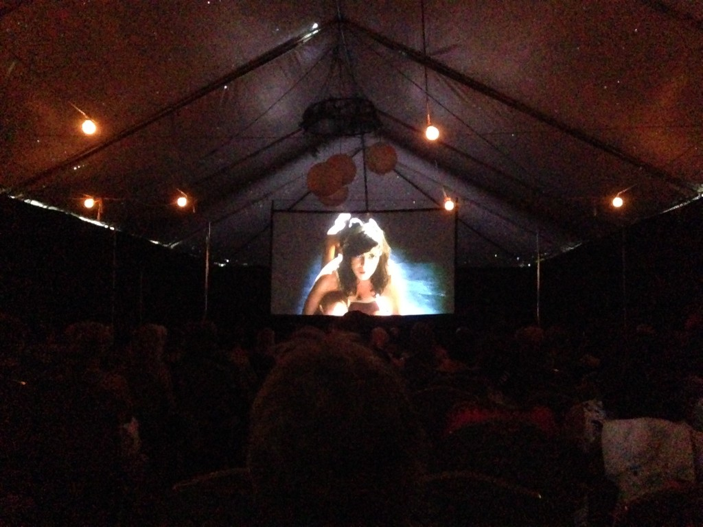 The movie playing in front of a packed house (tent!)